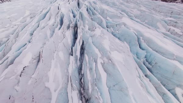Aerial shot of glacier in Iceland, pan up fly over. Rights-managed stock video