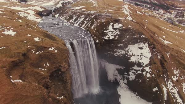 Aerial fly by over Skógafoss waterfall in Iceland. Rights-managed stock video