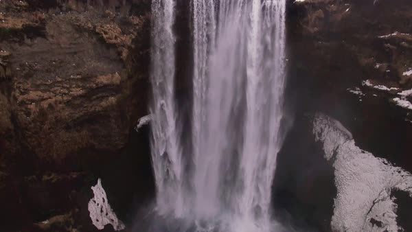 Aerial pan up over Skógafoss waterfall in Iceland. Rights-managed stock video