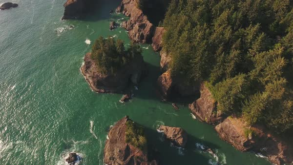 Oregon coast sunset flight reveal aerial Rights-managed stock video