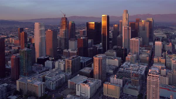 Los Angeles cityscape aerial sunset pan. Rights-managed stock video