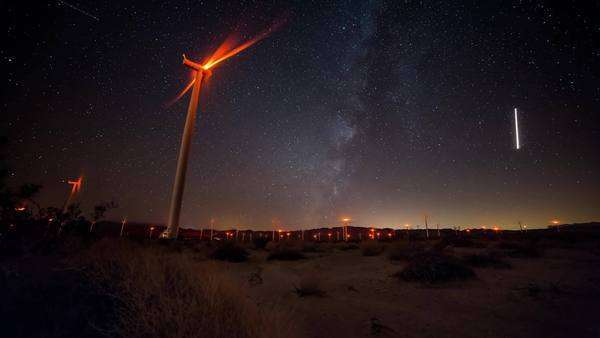Timelapse dolly shot of Wind Turbines with Milky Way in the Anza Borrego Desert. Rights-managed stock video