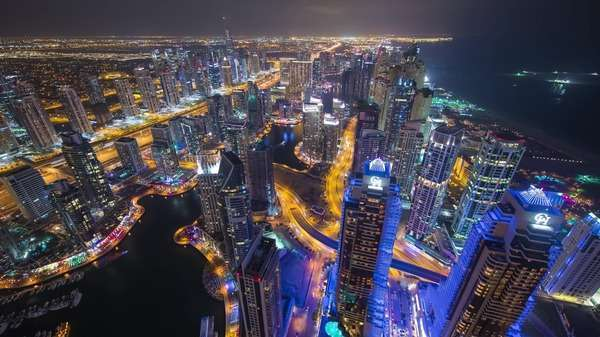 Static timelapse birds eye busy Dubai Marina Cityscape at night. Rights-managed stock video