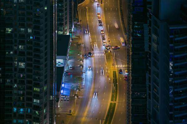 Static timelapse birds eye busy Dubai Street at night. Rights-managed stock video