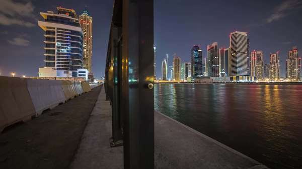 Dolly timelapse Dubai cityscape at night. Rights-managed stock video