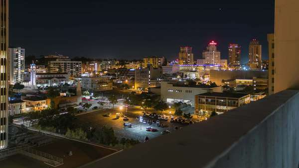 Timelapse dolly shot of San Diego Downtown off building at night. Rights-managed stock video