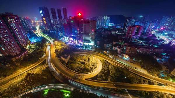 Night light traffic round crossroad roof top panorama timelapse Shenzhen China Royalty-free stock video