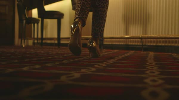Static shot of a woman in high-heeled shoes sitting down on a chair Royalty-free stock video