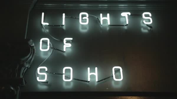 Hand-held shot of a neon sign of Lights of Soho Royalty-free stock video