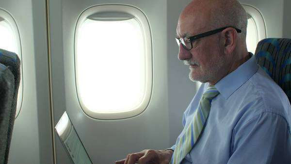 Man travels with laptop on airplane Royalty-free stock video