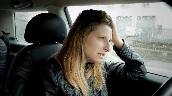 Despaired sad young woman crying while driving car dark rainy day, relationship problem Royalty-free stock video