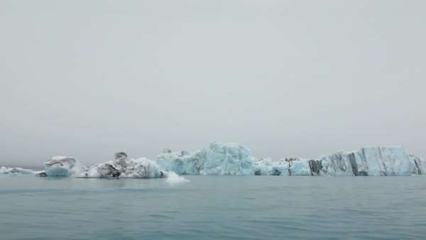 Sailing slowly through the icy waters of Jokulsarlon, Iceland Royalty-free stock video