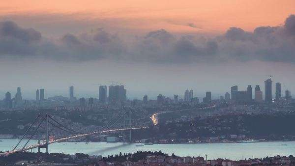 Istanbul city skyline cityscape time lapse from day to night view of Bosphorus bridge and financial business center  Royalty-free stock video
