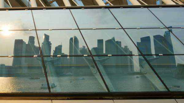 Singapore,singapore,15/08/2015:unusual view of modern city skyline of singapore as seen reflected on a mirror at the sunset establishing shot Royalty-free stock video