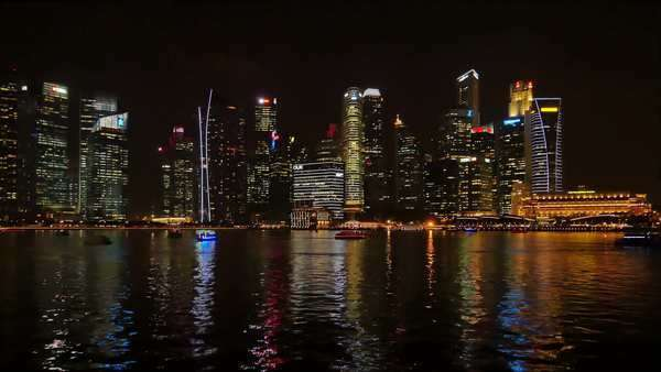 Singapore,indonesia,15/08/2015:singapore seafront marina bay illuminated at night modern city skyscrapers background Royalty-free stock video