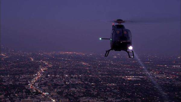 Wide shot of a flying helicopter at night Royalty-free stock video