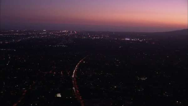 Aerial shot of an illuminated city at sunset Royalty-free stock video