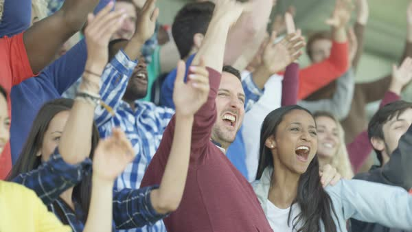 Excited sports fans at live game chanting & cheering for their team Royalty-free stock video