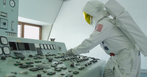 Astronaut in space mission control room, pressing switches and running away Royalty-free stock video