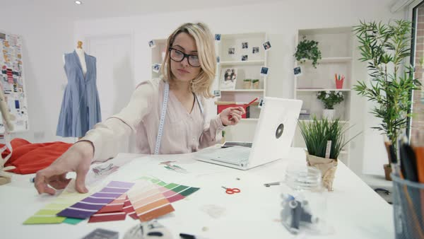 Fashion designer working at her desk in creative studio Royalty-free stock video