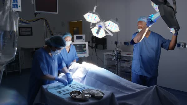 Time lapse team of surgeons in operating theater performing operation on a pa Royalty-free stock video