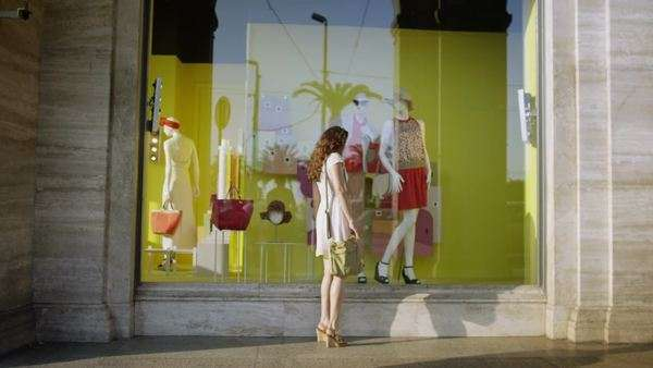Beautiful woman window shopping in the city Royalty-free stock video