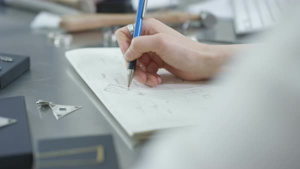 Close-up of jewelry designer at work in studio sketching out designs Royalty-free stock video