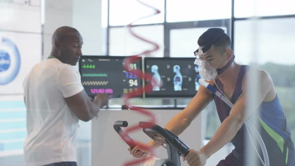 Sports professional analyzing man's fitness levels with high tech equipment Royalty-free stock video