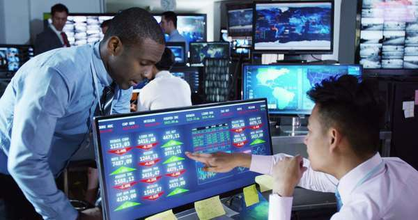 Team of financial brokers watching the world markets in a busy trading room Royalty-free stock video