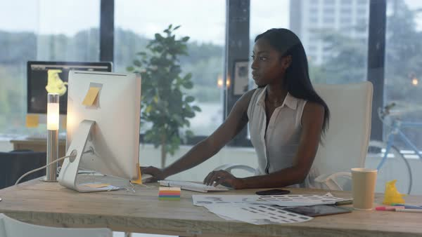 Attractive businesswoman working at her desk in creative office. Royalty-free stock video