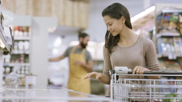 Customer shopping in frozen food aisle of supermarket Royalty-free stock video