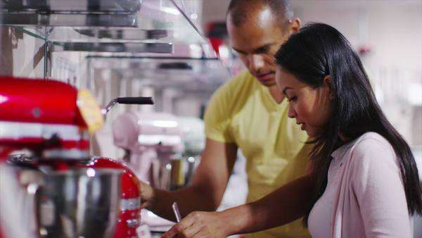 Couple shopping in a shop selling kitchen appliances. - Stock Video ...