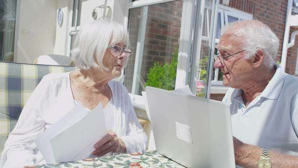 Senior couple together at home doing the accounts and worrying about paying bills Royalty-free stock video