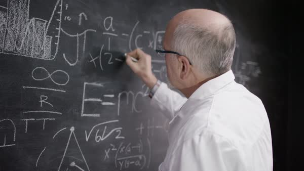 Portrait of academic man writing math formulas on blackboard. Royalty-free stock video