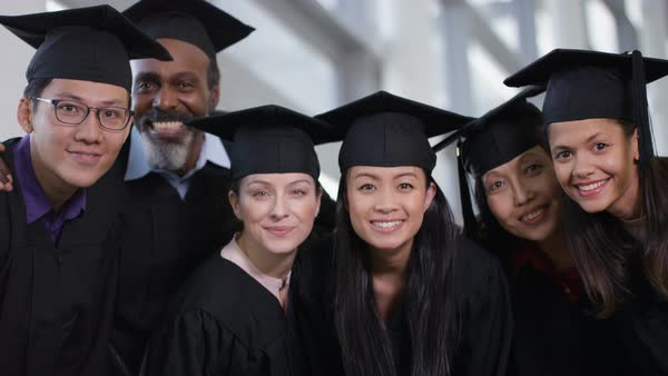 a417f2fa45 Portrait of happy group of mature students on graduation day. Royalty-free  stock video