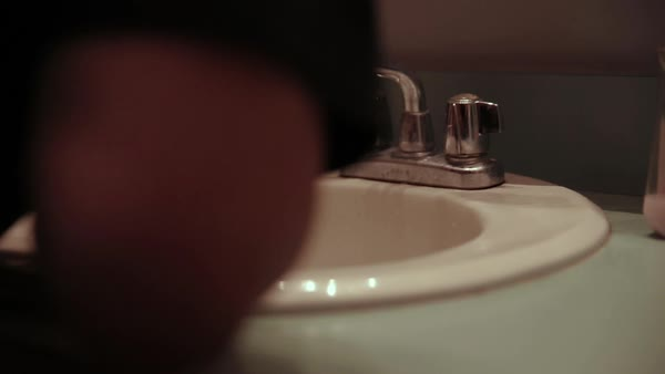 Hand-held shot of a man washing his face Royalty-free stock video