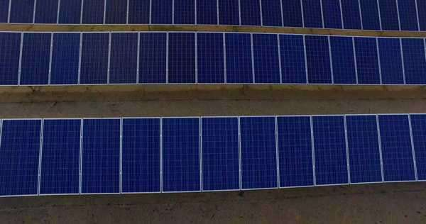 Medium shot of solar panels in a field Royalty-free stock video