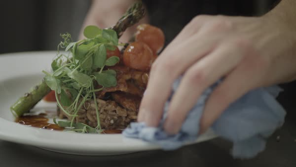 Close-up of hands preparing plate for serving Royalty-free stock video