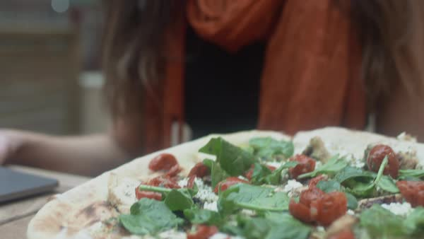 Slow motion of a pizza being served to a woman Royalty-free stock video