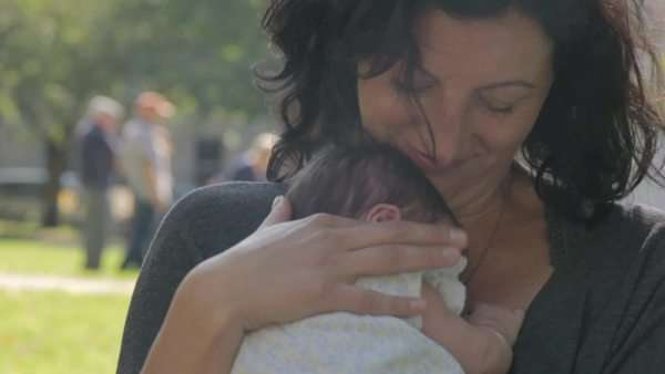 Medium shot of a mother caressing her baby Royalty-free stock video