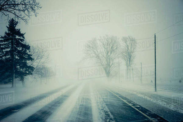 Road with blowing snow; Ontario, Canada Royalty-free stock photo