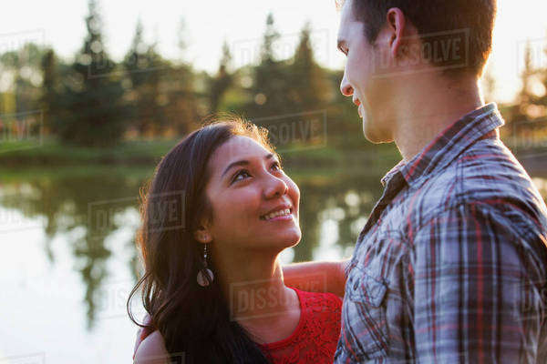 Mixed race couple spending quality time together in a park in autumn; St. Albert, Alberta, Canada Royalty-free stock photo