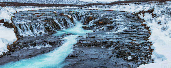Turquoise water flowing over rocks into a river; Bruarfoss, Iceland Royalty-free stock photo