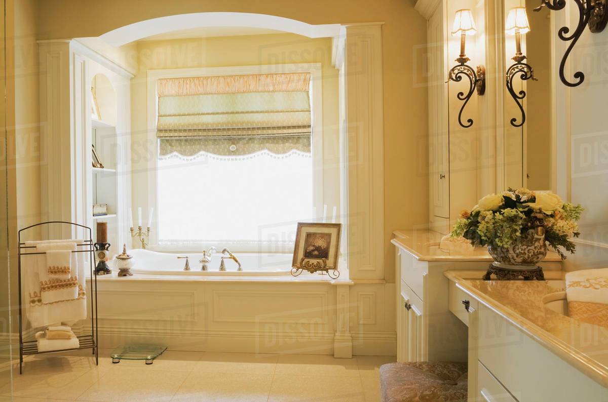 Modern Bathroom With White Wooden Vanity Units Inside A Lavishly Decorated And Luxurious Cottage Style Residential Home Quebec Canada