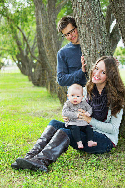 Married couple in a park with a baby; Edmonton, Alberta, Canada Royalty-free stock photo