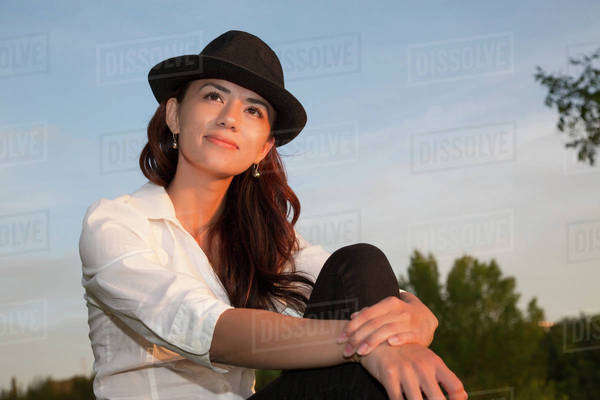 Portrait of a young woman enjoying an evening in a park; Edmonton, Alberta, Canada Royalty-free stock photo