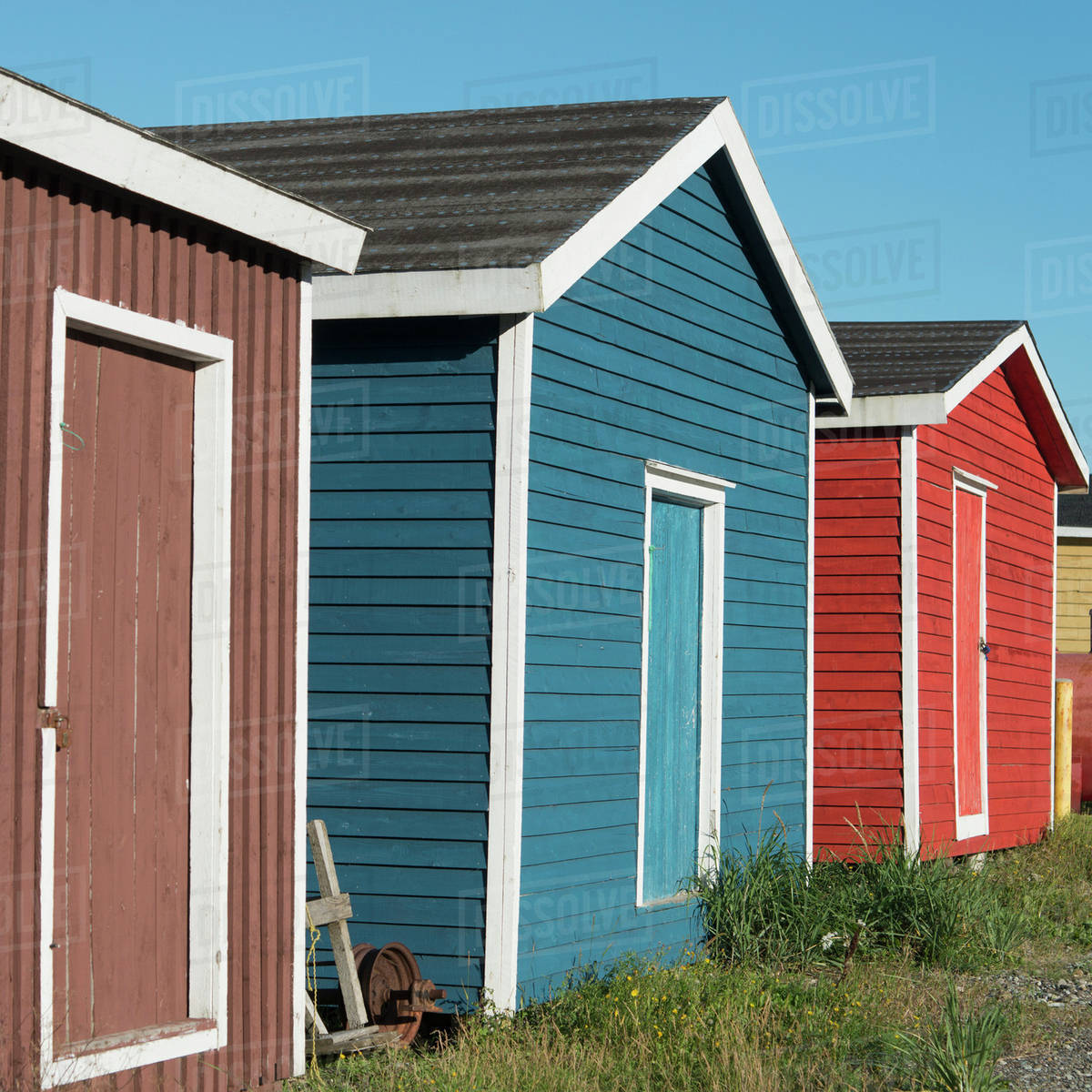 Sheds in various colours in a row