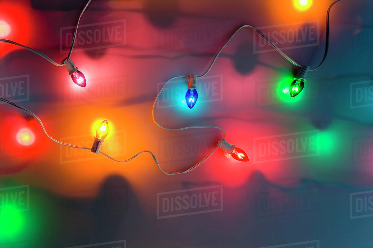one strand of multi colored large christmas tree lights glowing on