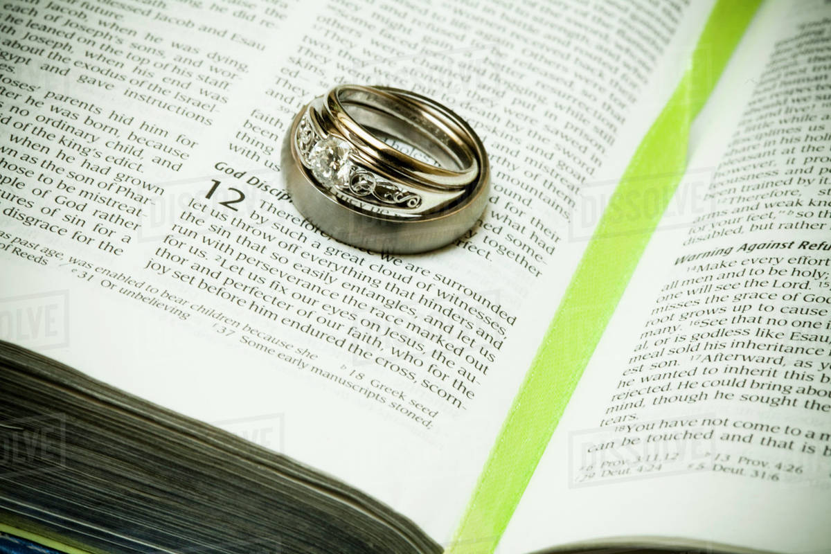 wedding rings placed on a page of the bible grand junction
