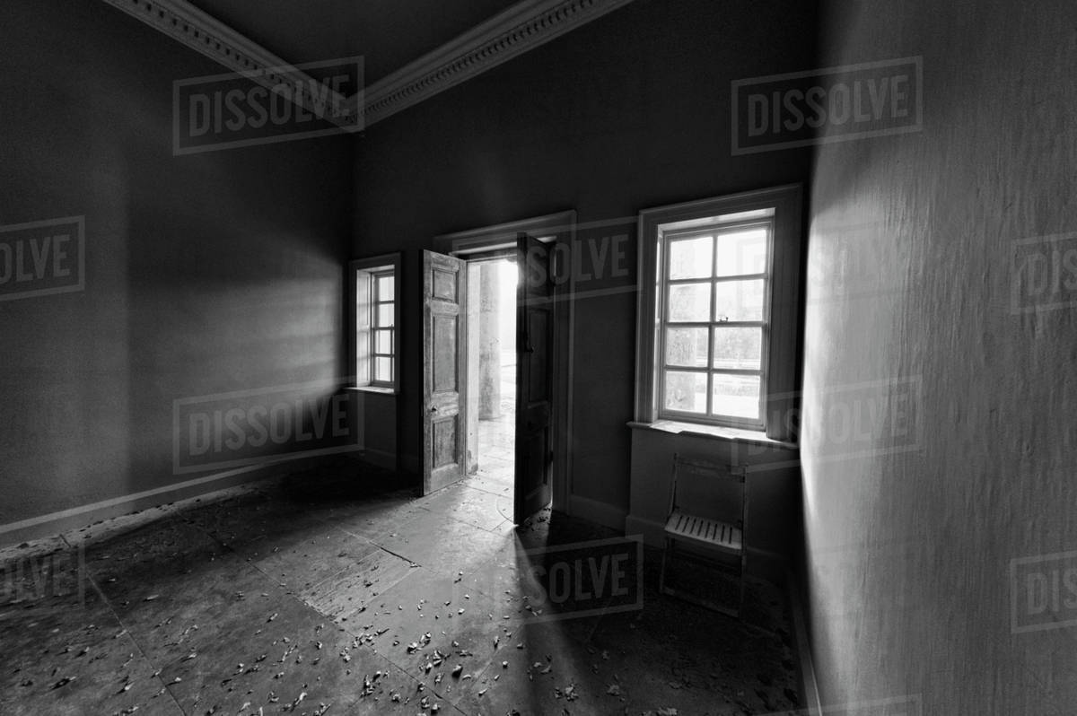 Light Shining Into A Dark Room Through An Open Door; North